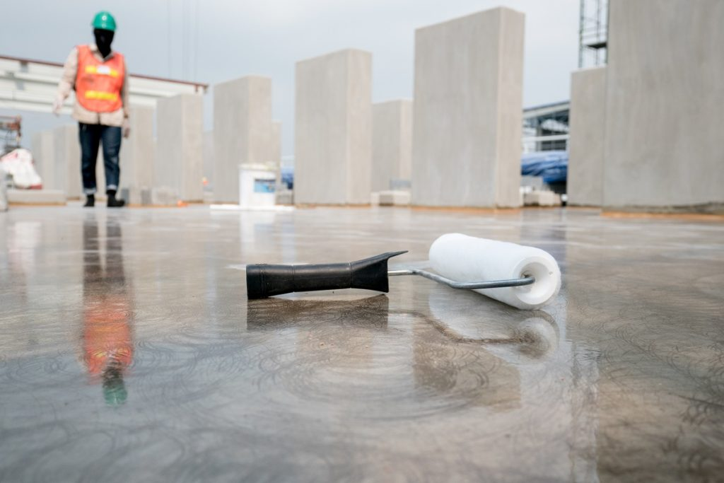 paint roller on concrete floor of construction