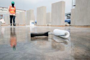 paint roller on concrete floor of construction